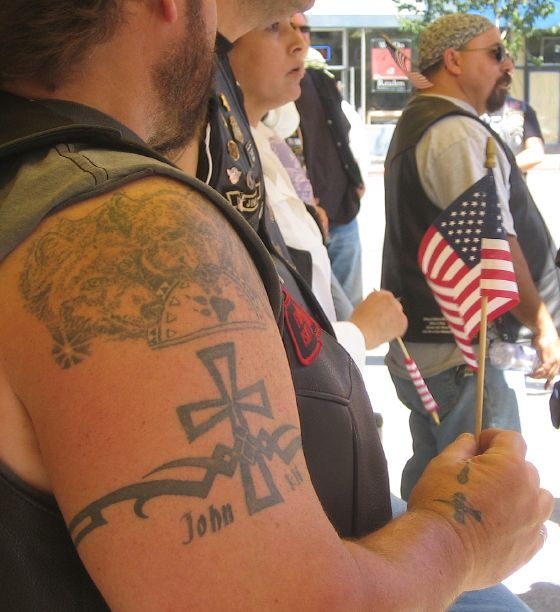 Here we have a tale of duelling tattoos. One of the Marines supporters had a
